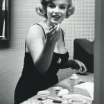 The jar of Elizabeth Arden cream can be seen on the table in front of Marilyn.