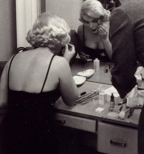 The table in front of Marilyn shows these three Elizabeth Arden makeup items.